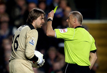 LONDON, ENGLAND - MAY 02:  Goalkeeper Tim Krul of Newcastle is shown the yellow card by Referee Mark Halsey during the Barclays Premier League match between Chelsea and Newcastle United at Stamford Bridge on May 2, 2012 in London, England.  (Photo by Juli