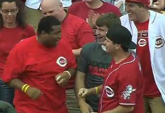 Reds fan Caleb Lloyd, left, caught two home run balls Monday night. (MLB.com)
