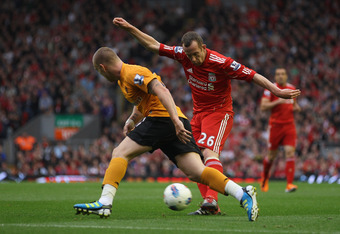 LIVERPOOL, ENGLAND - SEPTEMBER 24: Charlie Adam of Liverpool in action shortly before Roger Johnson (not pictured) of Wolves scored an own goal, during the Barclays Premier League match between Liverpool and Wolverhampton Wanderers at Anfield on September