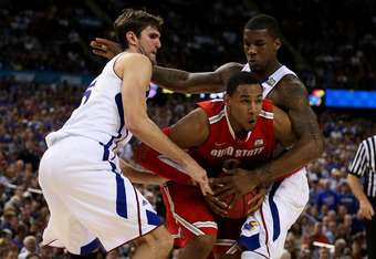 NEW ORLEANS, LA - MARCH 31:  Jared Sullinger #0 of the Ohio State Buckeyes with the ball between Jeff Withey #5 and Thomas Robinson #0 of the Kansas Jayhawks in the second half during the National Semifinal game of the 2012 NCAA Division I Men's Basketbal