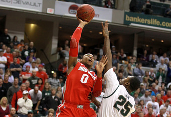 INDIANAPOLIS, IN - MARCH 11:  Jared Sullinger #0 of the Ohio State Buckeyes attempts a shot against Derrick Nix #25 of the Michigan State Spartans during the Final Game of the 2012 Big Ten Men's Conference Basketball Tournament at Bankers Life Fieldhouse