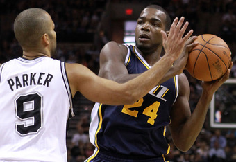 SAN ANTONIO, TX - APRIL 29:  Tony Parker #9 of the San Antonio Spurs and Paul Millsap #24 of the Utah Jazz  in Game One of the Western Conference Quarterfinals in the 2012 NBA Playoffs at AT&T Center on April 29, 2012 in San Antonio, Texas.  NOTE TO USER: