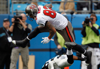 CHARLOTTE, NC - DECEMBER 24:   Kellen Winslow #82 of the Tampa Bay Buccaneers jumps over a defender for the Carolina Panthers during their game at Bank of America Stadium on December 24, 2011 in Charlotte, North Carolina.  (Photo by Streeter Lecka/Getty I