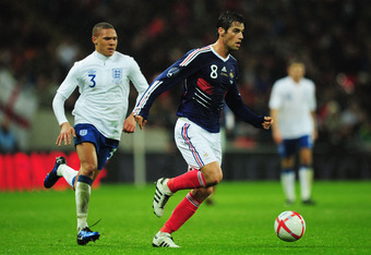 LONDON, ENGLAND - NOVEMBER 17:  Yoann Gourcuff of France evades Kieran Gibbs of England during the international friendly match between England and France at Wembley Stadium on November 17, 2010 in London, England.  (Photo by Shaun Botterill/Getty Images)