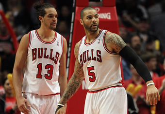CHICAGO, IL - APRIL 28: Joakim Noah #13 and Carlos Boozer #5 of the Chicago Bulls wait for a referees call against the Philadelphia 76ers in Game One of the Eastern Conference Quarterfinals during the 2012 NBA Playoffs at the United Center on April 28, 20