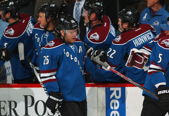 DENVER, CO - MARCH 20:  Paul Stastny #26 of the Colorado Avalanche celebrates his first period goal against the Calgary Flames with teammates at Pepsi Center on March 20, 2012 in Denver, Colorado. The Avalanche defeated the Flames 2-1 in overtime.  (Photo