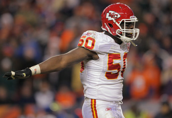 DENVER, CO - JANUARY 01:  Linebacker Justin Houston #50 of the Kansas City Chiefs celebrates after sacking quarterback Tim Tebow #15 of the Denver Broncos at Sports Authority Field at Mile High on January 1, 2012 in Denver, Colorado. The Chiefs defeated t