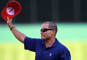 ARLINGTON, TX - APRIL 23:  Ivan 'Pudge' Rodriguez tips his Texas Rangers hat during a retirement ceremony before a game against the New York Yankees at Rangers Ballpark in Arlington on April 23, 2012 in Arlington, Texas.  (Photo by Ronald Martinez/Getty I