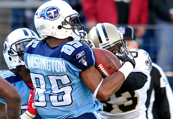 NASHVILLE, TN - DECEMBER 11:  Jabari Greer #33 of the New Orleans Saints breaks up a potential touvhdown pass to Nate Washington #85 of the Tennessee Titans during play at LP Field on December 11, 2011 in Nashville, Tennessee.  (Photo by Grant Halverson/G