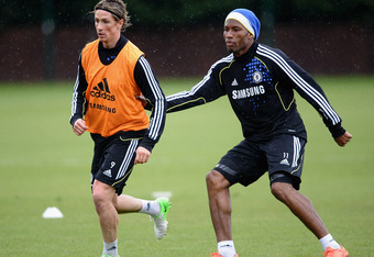 COBHAM, ENGLAND - MAY 15:  Fernando Torres (L) and Didier Drogba of Chelsea in action during training at Chelsea Training Ground on May 15, 2012 in Cobham, England.  (Photo by Laurence Griffiths/Getty Images)