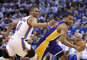 OKLAHOMA CITY, OK - MAY 16:  Ramon Sessions #7 of the Los Angeles Lakers drives inside on Russell Westbrook #0 of the Oklahoma City Thunder in Game Two of the Western Conference Semifinals during the 2012 NBA Playoffs on May 16, 2012 at the Chesapeake Ene