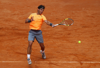 ROME, ITALY - MAY 21:  Rafael Nadal of Spain plays a forehand in his match against Novak Djokovic of Serbia in the final during day ten of the Internazionali BNL d'Italia 2012 Tennis on May 21, 2012 in Rome, Italy.  (Photo by Julian Finney/Getty Images)