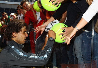 ROME, ITALY - MAY 21:  Rafael Nadal  of Spain signs autographs for fans after his straight sets victory against Novak Djokovic of Serbia in their final match during day ten of the Internazionali BNL d'Italia 2012 at the Foro Italico Tennis Centre on May 2