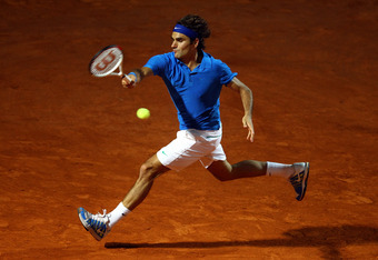 ROME, ITALY - MAY 19:   Roger Federer of Switzerland plays a forehand in his match against Novak Djokovic of Serbia during day eight of the Internazionali BNL d'Italia 2012 Tennis on May 19, 2012 in Rome, Italy.  (Photo by Julian Finney/Getty Images)