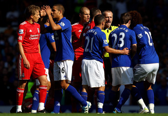 LIVERPOOL, ENGLAND - OCTOBER 01:  Jack Rodwell of Everton walks off after being shown a red card by Referee Martin Atkinson following a challenge on Luis Suarez of Liverpool during the Barclays Premier League match between Everton and Liverpool at Goodiso
