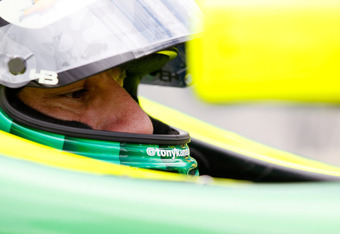BIRMINGHAM, AL - MARCH 30:  Tony Kanaan of Brazil, driver of the #11 KV Racing Technology Chevrolet, waits in the pits during practice for the IndyCar Series Honda Indy Grand Prix of Alabama presented by Legacy at Barber Motorsports Park on March 30, 2012