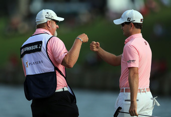 PONTE VEDRA BEACH, FL - MAY 13:  Zach Johnson of the United States celebrates at the par 4, 18th hole with his caddie Damon Green during the final round of THE PLAYERS Championship held at THE PLAYERS Stadium course at TPC Sawgrass on May 13, 2012 in Pont