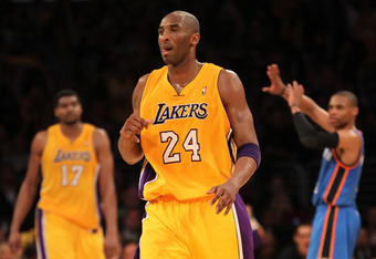 LOS ANGELES, CA - MAY 19:  Kobe Bryant #24 of the Los Angeles Lakers reacts after he makes a three-pointer as time expires in the third quarter over Russell Westbrook #0 of the Oklahoma City Thunder in Game Four of the Western Conference Semifinals in the