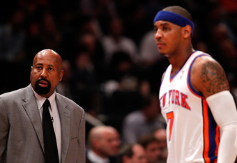 NEW YORK, NY - MAY 03:  (L-R) Head coach Mike Woodson and Carmelo Anthony #7 of the New York Knicks look on against the Miami Heat in Game Three of the Eastern Conference Quarterfinals in the 2012 NBA Playoffs on May 3, 2012 at Madison Square Garden in Ne