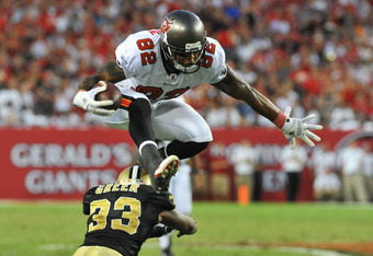 TAMPA, FL - OCTOBER 16: Tight end Kellen Winslow #82 of the Tampa Bay Buccaneers leaps over cornerback Jabari Greer #33 of the New Orleans Saints during play October 16, 2011 at Raymond James Stadium in Tampa, Florida. (Photo by Al Messerschmidt/Getty Ima