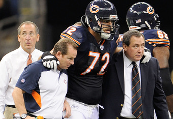 NEW ORLEANS, LA - SEPTEMBER 18:  Gabe Carimi #72 of the Chicago Bears is helped off the field at the Louisiana Superdome on September 18, 2011 in New Orleans, Louisiana.  The Saints defeated the Bears 30-13.(Photo by Stacy Revere/Getty Images)