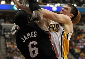 INDIANAPOLIS, IN - MAY 20: LeBron James #6 of the Miami Heat knocks the ball away from Tyler Hansbrough #50 of the Indiana Pacers in Game Four of the Eastern Conference Semifinals in the 2012 NBA Playoffs at Bankers Life Fieldhouse on May 20, 2012 in Indi