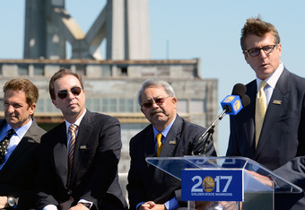 SAN FRANCISCO, CA - MAY 22:  President & COO of the Golden State Warriors Rick Welts speaks as (L-R) Co-Executive Chairman's Peter Guber and Joe Lacob, and Mayor Edwin M. Lee looks on at a press conference with the Golden State Warriors announcing plans t