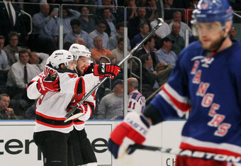 NEW YORK, NY - MAY 23:  Travis Zajac #19 and Zach Parise #9 of the New Jersey Devils celebrate their 5 to 3 win over the New York Rangers in Game Five of the Eastern Conference Final during the 2012 NHL Stanley Cup Playoffs at Madison Square Garden on May