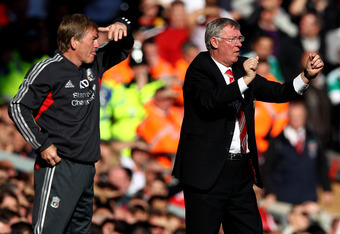 LIVERPOOL, ENGLAND - OCTOBER 15:  Manchester United Manager Sir Alex Ferguson (R) gestures as Liverpool Manager Kenny Dalglish looks on during the Barclays Premier League match between Liverpool and Manchester United at Anfield on October 15, 2011 in Live