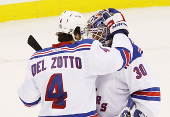 NEWARK, NJ - MAY 19:  Michael Del Zotto #4 and Henrik Lundqvist #30 of the New York Rangers celebrate their 3 to 0 win over the New Jersey Devils in Game Three of the Eastern Conference Final during the 2012 NHL Stanley Cup Playoffs at the Prudential Cent