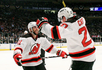 NEW YORK, NY - MAY 23:  Ryan Carter #20 of the New Jersey Devils celebrates his third period goal with Stephen Gionta #11 in Game Five of the Eastern Conference Final against the New York Rangers during the 2012 NHL Stanley Cup Playoffs at Madison Square