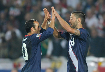 RUSTENBURG, SOUTH AFRICA - JUNE 12:  Clint Dempsey (R) and Landon Donovan of the United States celebrate at the final whistle during the 2010 FIFA World Cup South Africa Group C match between England and USA at the Royal Bafokeng Stadium on June 12, 2010