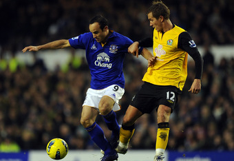 LIVERPOOL, ENGLAND - JANUARY 21:  Landon Donovan of Everton in action with Morten Gamst-Pedersen of Blackburn Rovers during the Barclays Premier League match between Everton and Blackburn Rovers at Goodison Park on January 21, 2012 in Liverpool, England.