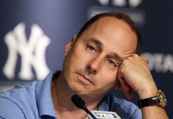 Several Yankees executives, including general manager Brian Cashman, deny that the Steinbrenner family wants to sell the team.