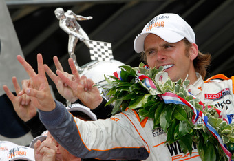 INDIANAPOLIS, IN - MAY 29:  Dan Wheldon of England, driver of the #98 William Rast-Curb/Big Machine Dallara Honda, celebrates in victory circle after winning the IZOD IndyCar Series Indianapolis 500 Mile Race at Indianapolis Motor Speedway on May 29, 2011