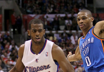 LOS ANGELES, CA - APRIL 16:  Chris Paul #3 of the Los Angeles Clippers drives around Russell Westbrook #0 of the Oklahoma City Thunder at Staples Center on April 16, 2012 in Los Angeles, California.  The Clippers won 92-77.  NOTE TO USER: User expressly a