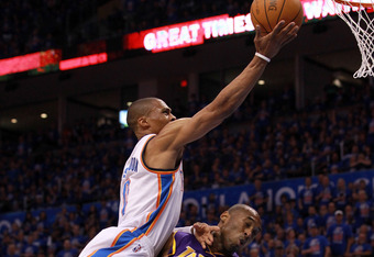 OKLAHOMA CITY, OK - MAY 21:  Russell Westbrook #0 of the Oklahoma City Thunder goes up for a shot over Kobe Bryant #24 of the Los Angeles Lakers in the first quarter during Game Five of the Western Conference Semifinals of the 2012 NBA Playoffs at Chesape