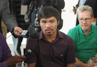 NEW YORK, NY - SEPTEMBER 06:  Professional Boxer Manny Pacquiao (pictured, C) is interviewed while his trainer Freddie Roach before the press conference for his World Welterweight Championship Fight with Juan Manuel Marquez at The Lighthouse at Chelsea Pi