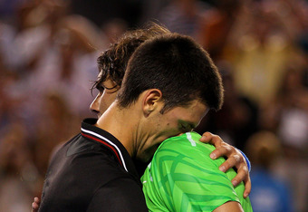 MELBOURNE, AUSTRALIA - JANUARY 29:  Novak Djokovic of Serbia hugs Raphael Nadal of Spain after his men's final match against Rafael Nadal of Spain during day fourteen of the 2012 Australian Open at Melbourne Park on January 29, 2012 in Melbourne, Australi