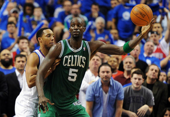 PHILADELPHIA, PA - MAY 23: Kevin Garnett #5 of the Boston Celtics catches the ball in front of Evan Turner #12 of the Philadelphia 76ers in Game Six of the Eastern Conference Semifinals in the 2012 NBA Playoffs at the Wells Fargo Center on May 23, 2012 in