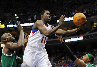 PHILADELPHIA, PA - MAY 23: Jrue Holiday #11 of the Philadelphia 76ers lays up a shot past Kevin Garnett #5 and Paul Pierce #34 of the Boston Celtics in Game Six of the Eastern Conference Semifinals in the 2012 NBA Playoffs at the Wells Fargo Center on May