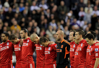 WEST BROMWICH, ENGLAND - OCTOBER 29:  The Liverpool players observe a minutes silence ahead of Remembrance Day prior to the Barclays Premier League match between West Bromwich Albion and Liverpool at The Hawthorns on October 29, 2011 in West Bromwich, Eng