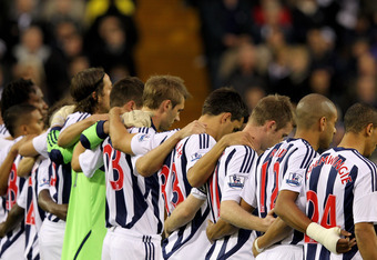 WEST BROMWICH, ENGLAND - OCTOBER 29:  The West Bromwich Albion players observe a minutes silence ahead of Remembrance Day prior to the Barclays Premier League match between West Bromwich Albion and Liverpool at The Hawthorns on October 29, 2011 in West Br