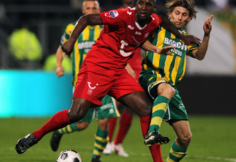 THE HAGUE, NETHERLANDS - MARCH 24:  Ebi Smolarek of Den Haag and Douglas of Twente battle for the ball during the Eredivisie match between ADO Den Haag and FC Twente at Kyocera Stadium on March 24, 2012 in The Hague, Netherlands.  (Photo by Dean Mouhtarop