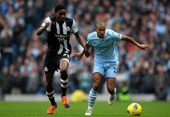 MANCHESTER, UNITED KINGDOM - NOVEMBER 19:  Gael Clichy of Manchester City competes with Sammy Ameobi of Newcastle United during the Barclays Premier League match between Manchester City and Newcastle United at the City of Manchester Stadium on November 19