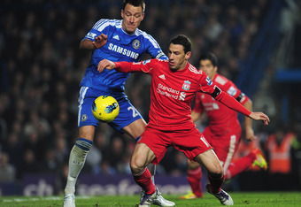 LONDON, ENGLAND - NOVEMBER 20:  Maxi Rodriguez of Liverpool is closed down by John Terry of Chelsea during the Barclays Premier League match between Chelsea and Liverpool at Stamford Bridge on November 20, 2011 in London, England.  (Photo by Shaun Botteri