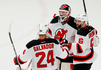 NEW YORK, NY - MAY 23:  Martin Brodeur #30, Bryce Salvador #24 and Andy Greene #6 of the New Jersey Devils celebrate their 5 to 3 win over the New York Rangers in Game Five of the Eastern Conference Final during the 2012 NHL Stanley Cup Playoffs at Madiso