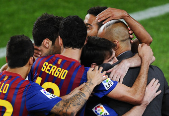 BARCELONA, SPAIN - MAY 05:  Lionel Messi of FC Barcelona (2ndR) hugs his Head coach Josep Guardiola of FC Barcelona after scoring his team's third goal during the La Liga match between FC Barcelona and RCD Espanyol at Camp Nou on May 5, 2012 in Barcelona,