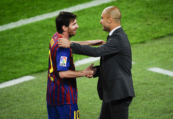 BARCELONA, SPAIN - MAY 05:  Lionel Messi of FC Barcelona (R) shakes hands with his Head coach Josep Guardiola of FC Barcelona after scoring his team's third goal during the La Liga match between FC Barcelona and RCD Espanyol at Camp Nou on May 5, 2012 in