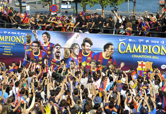 BARCELONA, SPAIN - MAY 29:  FC Barcelona players celebrate on board an open top bus after winning the UEFA Champions League Final against Manchester United, on May 29, 2011 in Barcelona, Spain.  (Photo by David Ramos/Getty Images)